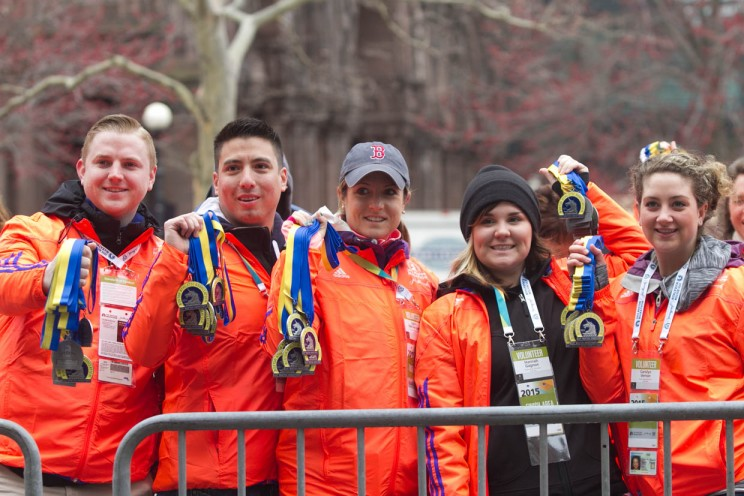 Boston. April 20, 2015. Volunteers at the 2015 Boston Marathon Monday hold the medals near the finish line on Boylston Street on Monday morning. (Photo by: Pankaj Khadka/BU News Service)