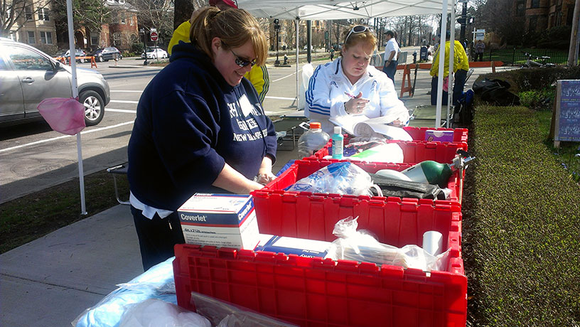 Sisters Kim Binsfield and Sheila Sjosfelt prep medical supplies before the race. (Natalie Covate/BU News Service)