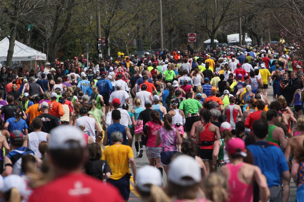A huge influx of runners and their supporters fill hotel rooms, restaurants and businesses in the Boston area. (BU News Service)