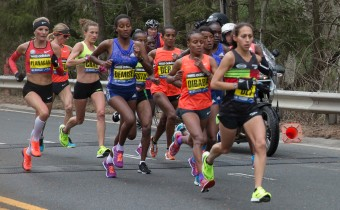 Boston. April 20, 2015. The elite women run past the 13-mile mark at the 2015 Boston marathon. (Dingfang Zhou/BU News Service)