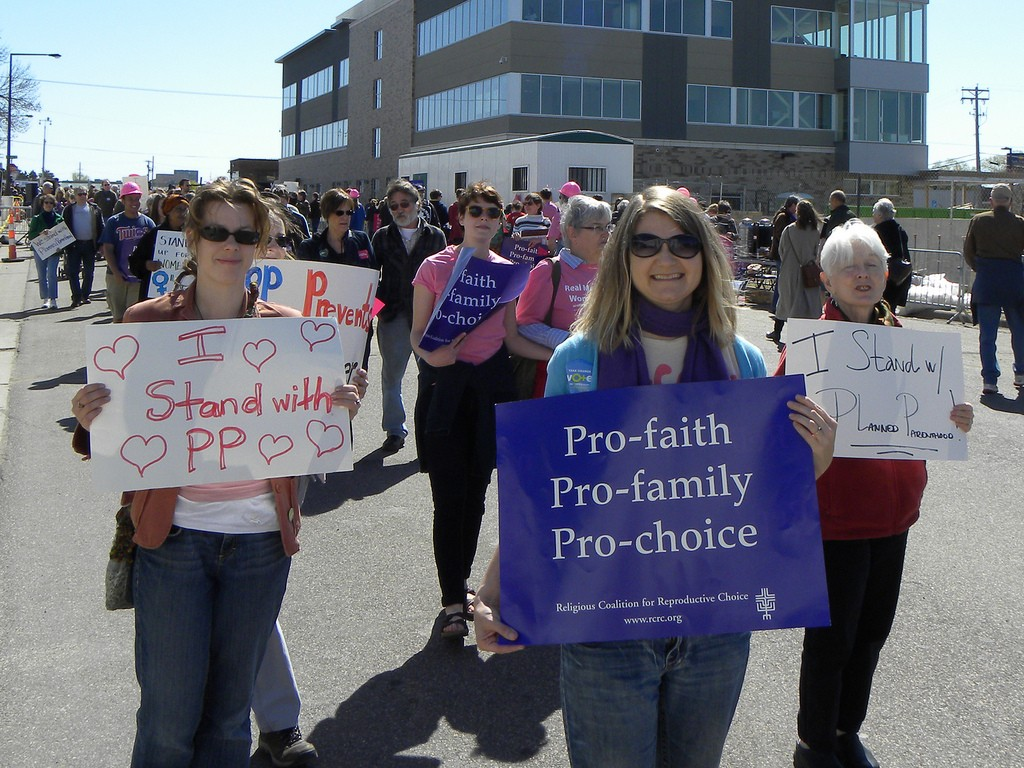 Rally to support Planned Parenthood. Photo courtesy by flickr user Fibonacci Blue.
