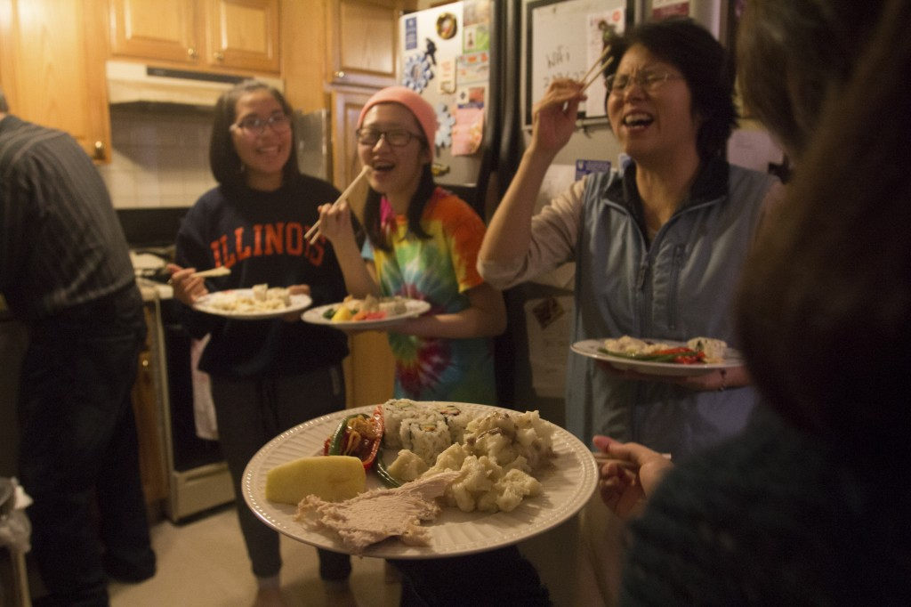 Chicago, IL, 26th Nov, 2015: From left: Yoshie Rabottini, Reicy Choe and Etsuko Singer eat Thanksgiving dinner in a suburb outside of Chicago, Ill. on Novermber 26, 2015. There was a mix of American, Japanese and Korean cuisine brought by a mix of American, Japanese and Korean families. (Photo by: Ann Singer/BUNS)