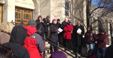 Boston University professor Abigail Gilman speaks at a rally honoring Martin Luther King, Jr., at BU's Marsh Plaza on Monday, January 18. (Photo by Libby Allen)