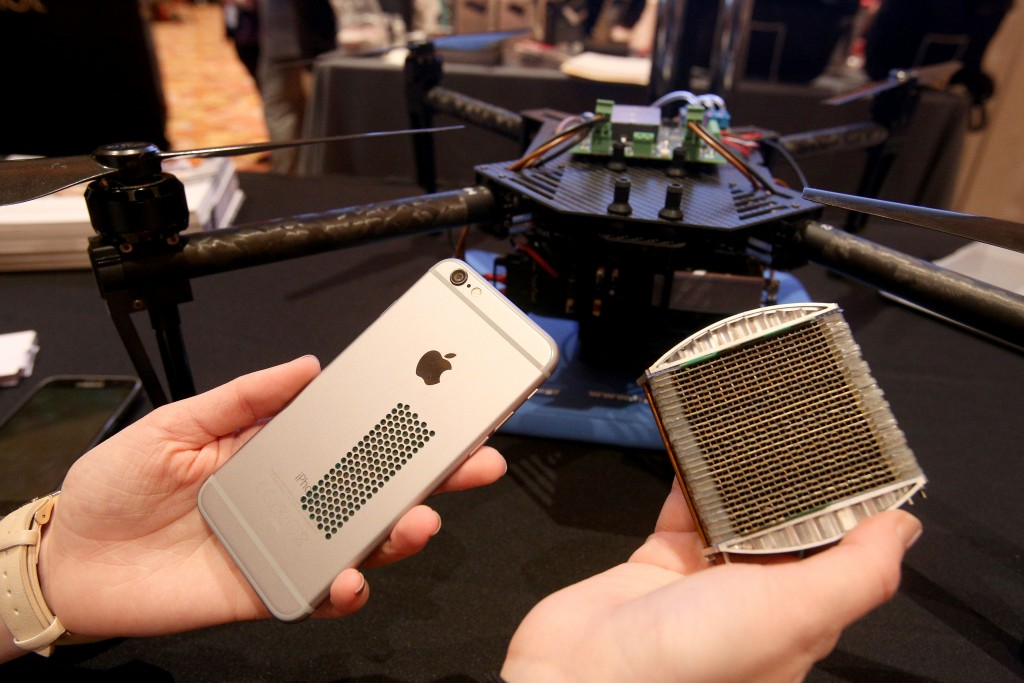 An Apple iPhone and a quadcopter, both retrofitted with hyrdogen fuel cell batteries, and a hydrogen fuel cell are displayed by Intelligent Energy at ShowStoppers. Photo by Ann Singer.