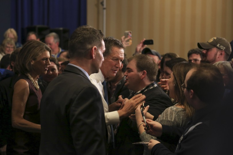 Concord, NH, Feb 9th, 2016: Republican presidential candidate shakes hand with supporters after his speech at Concord Town Hall in Concord, N.H. Kasich finishes in 2nd place behind Trump. (Photo by: Xin Fang/BUNS)
