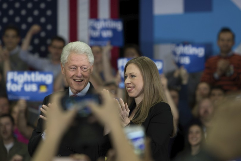 Manchester, NH, 9th Feb 2016: Hillary Clinton's husband Bill and daughter Chelsea look on as she delivered a speech after winning second place in the Democratic vote.  (Photo by: Jacob G. Dmochowski/BUNS)