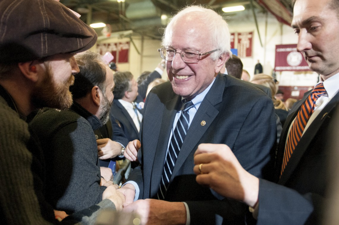Concord, NH, Feb 9th, 2016: Democratic candidate Bernie Sanders shakes hands with his supporters at Concord High School after winning the Democratic candidate vote in the New Hampshire primary. (Marwa Morgan/BUNS)
