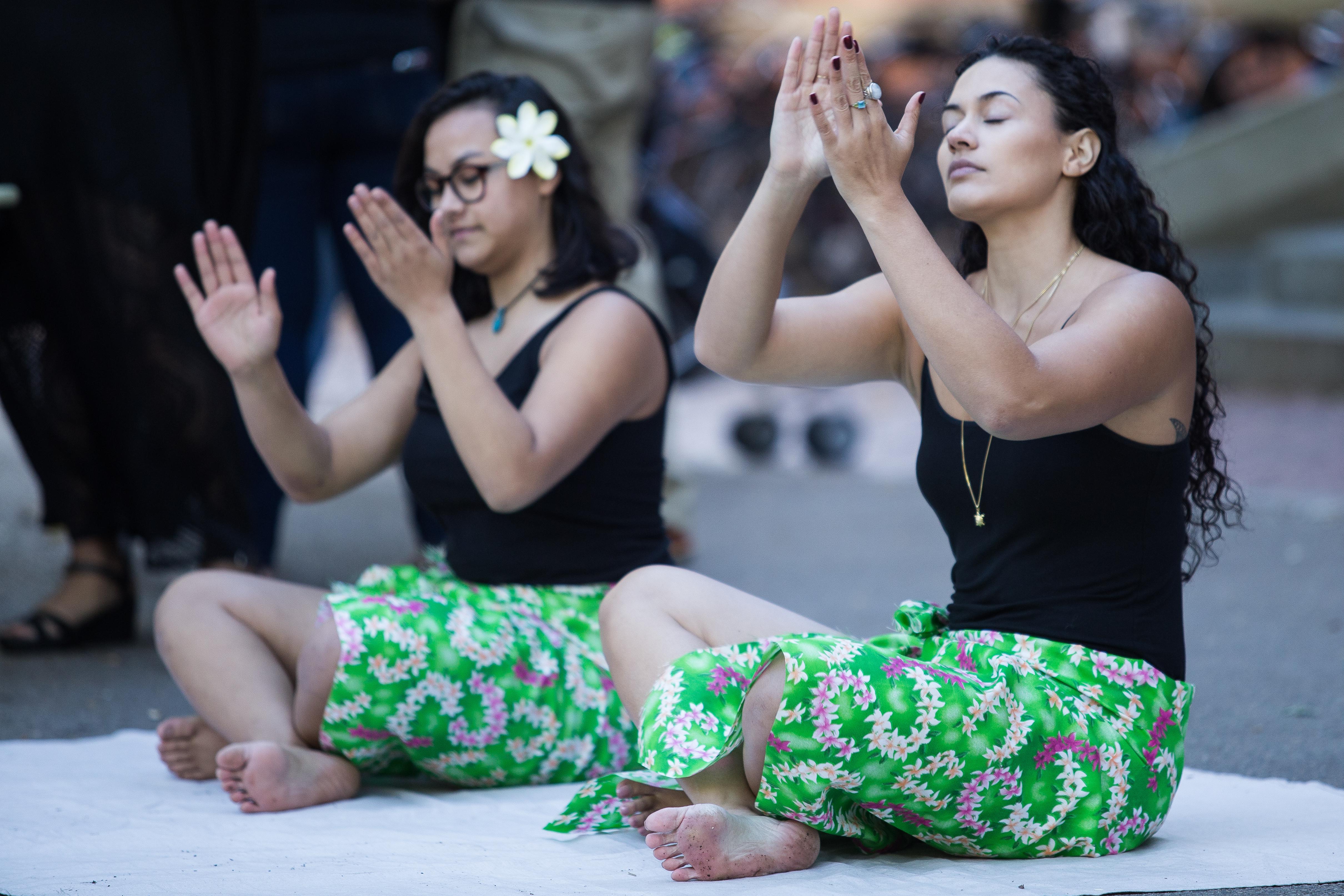 Pua Higginson (right) and Caroline Daley perform a Polynesian dance. Photo by Alexandra Wimley/BU News Service