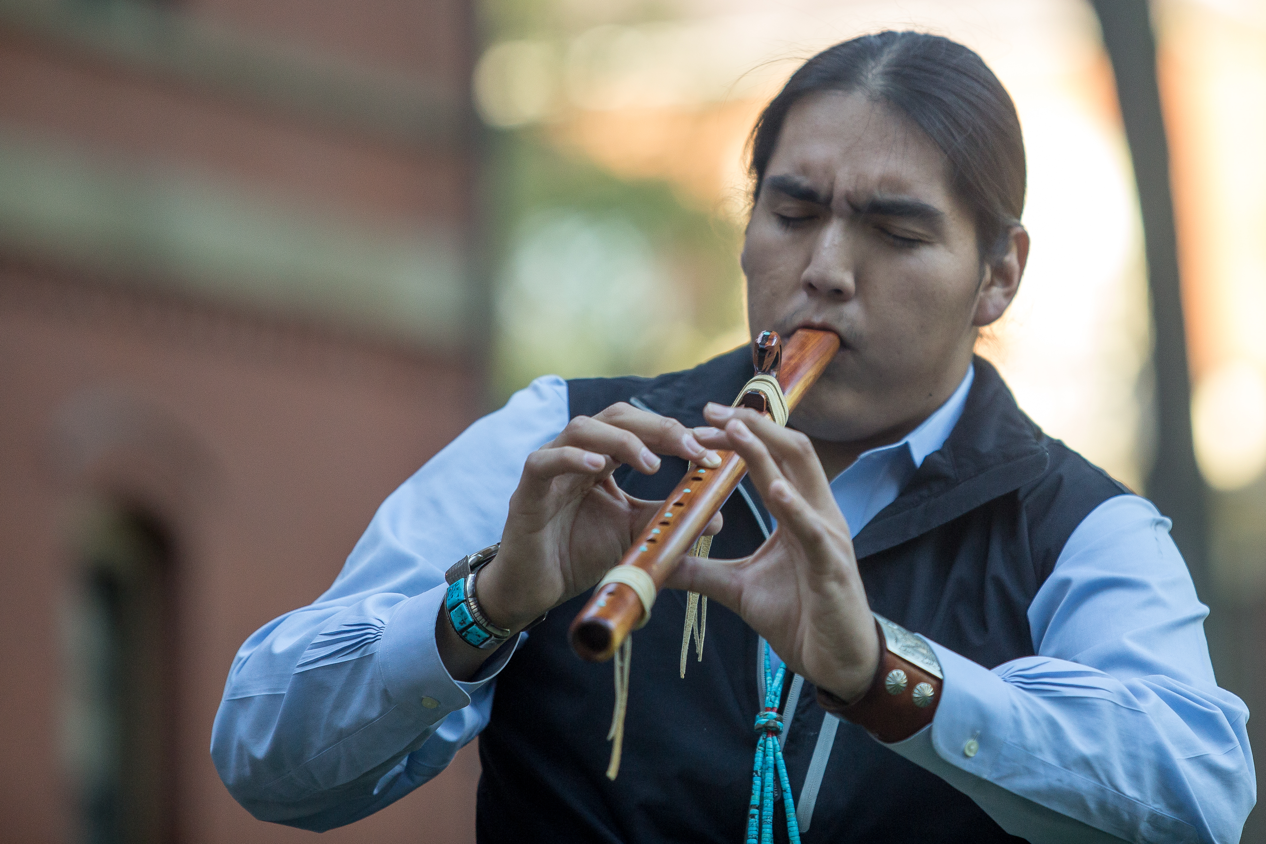 Clark performs a song on the flute at the Indigenous Peoples' Day celebration at Harvard University. Photo by Alexandra Wimley/BU News Service