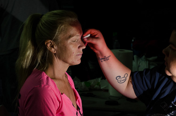 Makeup artist Denise McDonough (right) applies zombie makeup to a voluneer in preparation for the Boston Zombie Apocalypse. Photo by Crystal Milner/BU News Service