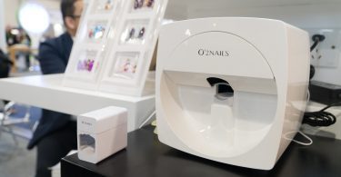 The O'2Nails mobile nail printer comes with an ultraviolet lamp for drying the nails. at Las Vegas Convention Center on Tuesday, Jan. 9th, 2018. Photo by Yukun Zhang / BU News Service.