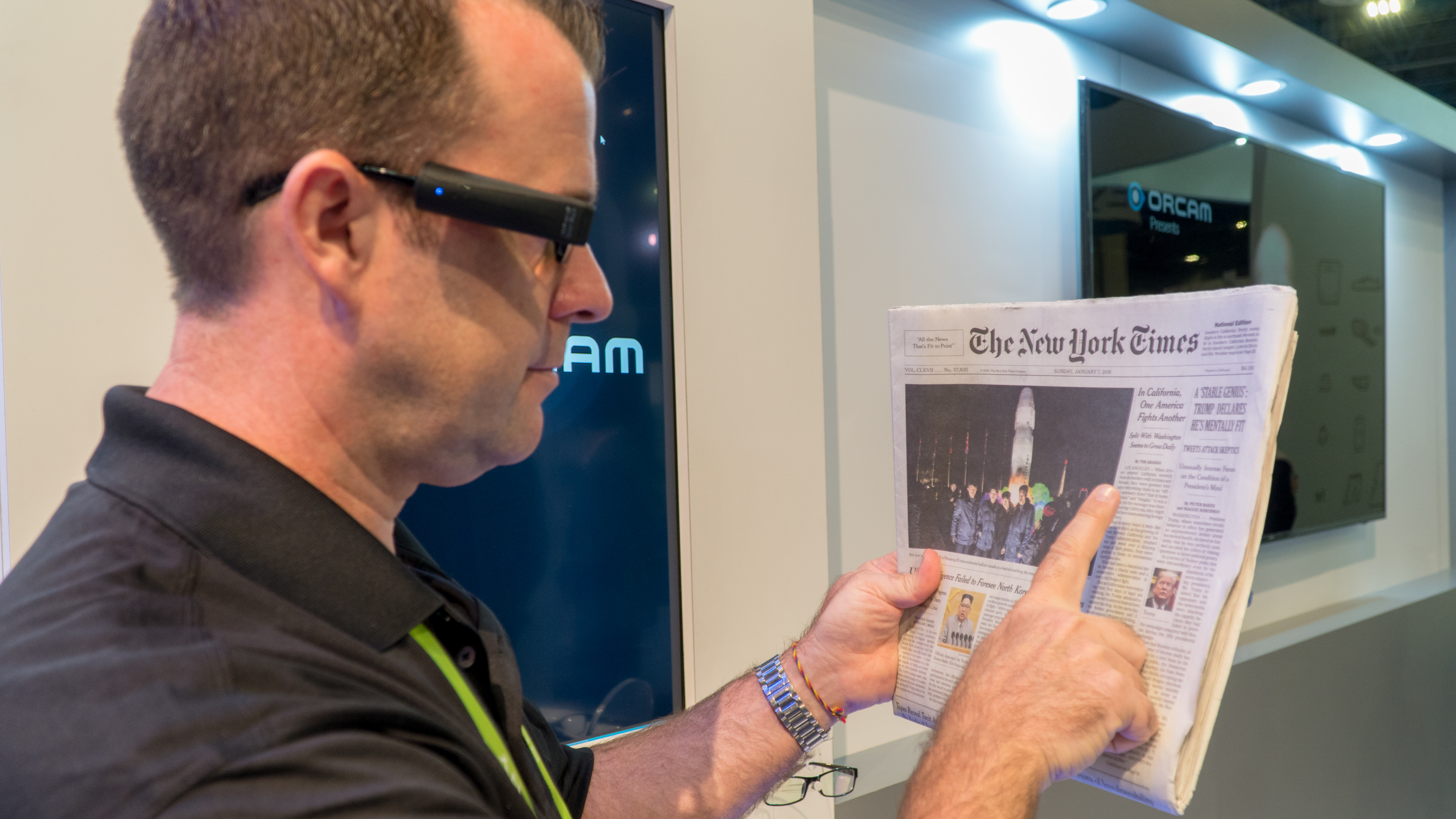 Rhys Filmer demonstrates the OrCam MyEye 2.0 at Sands Expo and Convention Center in Las Vegas on Wednesday, Jan. 10th, 2018. Photo by Yukun Zhang / BU News Service.