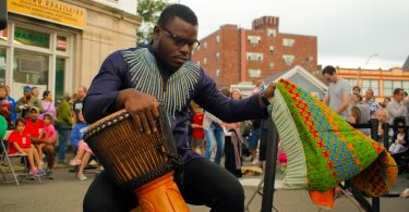 Jonathan Mande, 27, founder of Drums and Wellness prepares his Djembe drum at the 2018 Fluff Festival. Somerville, Mass. September 22, 2018. Photo by Diego Marcano / BU News Service.