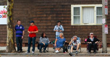 Families gathered on along Chelsea Street to watch the Columbus Day Parade in East Boston, on Sunday, Oct. 7. Photo by Flaviana Sandoval / BU News Service
