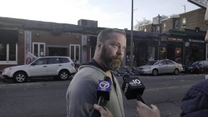 Bob O'Guin, owner of the Common Ground Bar & Grill, addresses the media after a partial roof collapse at Common Ground Bar & Grill in Allston, Nov. 4. Photo by Aaron Ye / BU News Service.