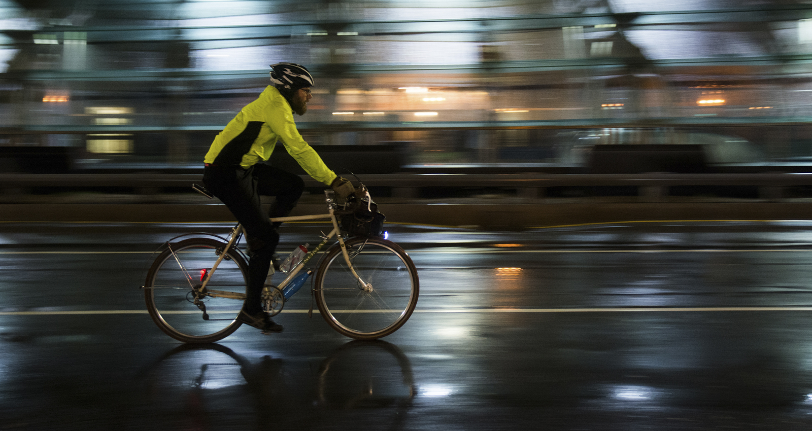 0eefc0a643f A cyclist passes through Kenmore Square early Monday moring during the  Midnight Bike Ride. Photo by Jessica Richardson  BU News Service